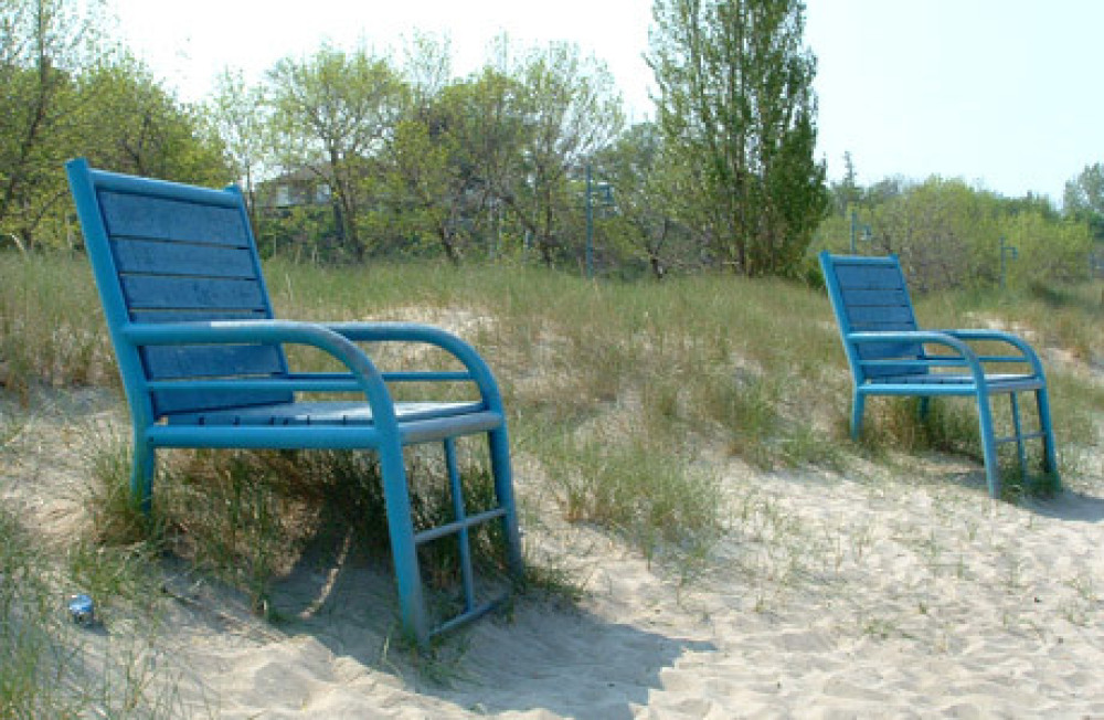 Big blue chairs on the beach